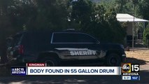 Two arrested after body found in 55-gallon drum buried in Kingman backyard