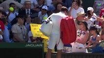 Roger Federer gives headband to fan at Wimbledon!