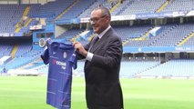 Maurizio Sarri Holds up Chelsea Shirt on Stamford Bridge Pitch