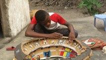 Budding 14-y/o architect builds football stadium models amid AFCON