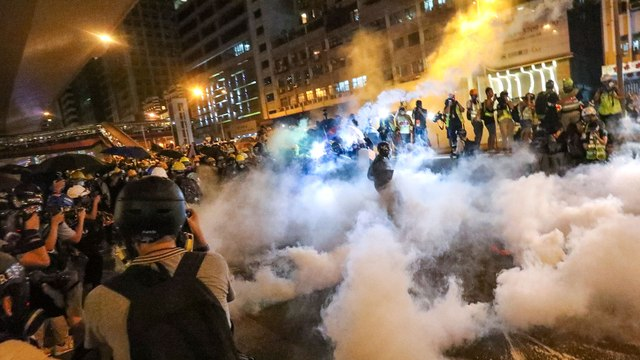 Central Hong Kong becomes battleground as riot police clash with protesters after third major march against extradition bill