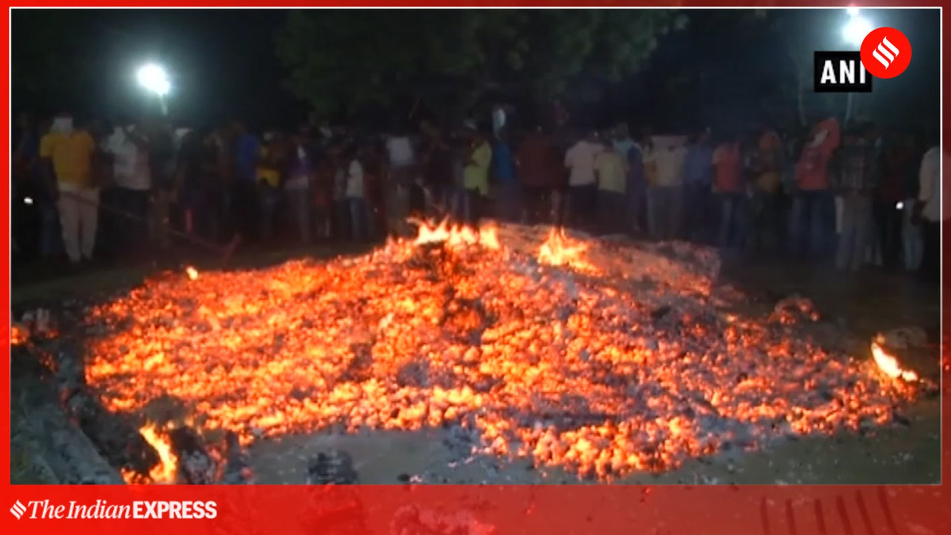 Holika Dahan: People walk on burning embers in Surat