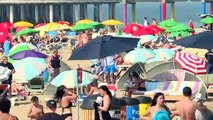 Water games and swimming as record-setting heatwave hits Europe