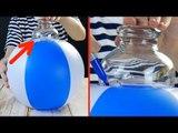 Cette femme presse un verre sur le ballon de plage pour...
