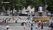 Locals and tourists cool off in London's fountains as blistering heatwave continues