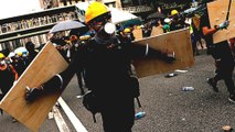 Defying police ban, HK protesters return to gang-attack scene