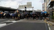 Tense standoff between Hong Kong protesters and police near China Liaison Office