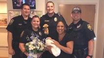 Wehen am Straßenrand: Polizisten helfen Frau bei Geburt