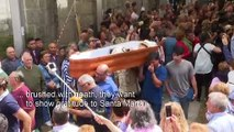 Spanish survivors of 'near-death experiences' parade in coffins