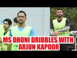 MS Dhoni dribbles with Arjun Kapoor