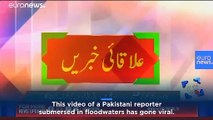 Reporter in Pakistan goes live from neck-deep floodwaters