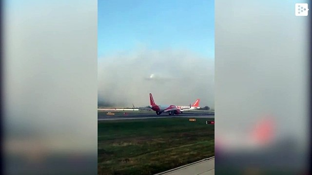 A huge Emirates plane appears 'out of nowhere' just before landing