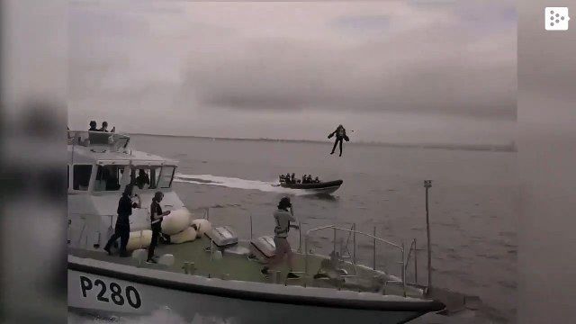 Richard Browning tests a special suit that allows him to 'fly' over the water