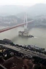 Five-storey building caught floating across China river in viral video