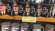 Tourist Horrified After Spotting Hitler Mugs And Wine