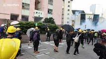 Protesters in Hong Kong hurl stones at living quarters of police as tensions mount