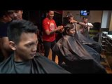 Business is good for Scottie Thompson's barber shop