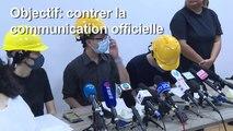 Hong Kong: des manifestants masqués devant la presse pour contrer la communication officielle