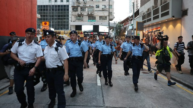 Fear remains in a residential district of Hong Kong, a day after clashes between extradition bill protesters and mobs armed with poles