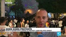 Hong Kong: people gather with lasers to protest laser-related arrest