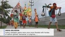 Saffron-clad, dope-using Indian pilgrims flood Ganges' plains to honor Shiva