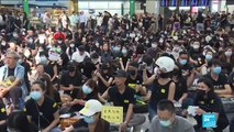 Hundreds stage sit-in protest at Hong Kong's international airport