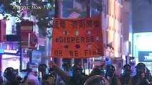 Hong Kong shopping district shrouded in tear gas in 'hit-and-run' demos