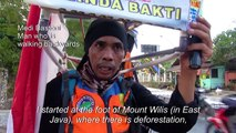Indonesian man walking in reverse to save forests