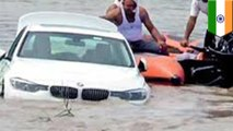 Indian man pushes birthday BMW into the river