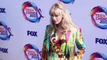 Taylor Swift announces new music while accepting Teen Choice award