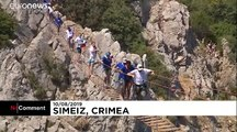 Divers compete in jumping off 27-metre cliff platform in Crimea