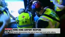 HK Int'l Airport reopens; U.S., Canada warn China not to intervene with force