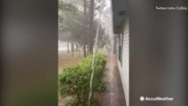Rooftop waterfalls during heavy rain