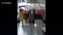 Five-year-old girl gets her arm stuck in escalator handrail at a mall in China