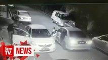 CCTV captures armed men with machete robbing Grab driver
