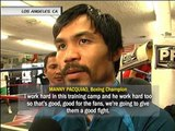 Pacquiao look-alike meets boxing superstar