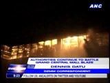 Fire at Caloocan mall continues to rage