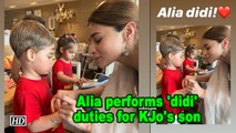 Alia performs 'didi' duties for KJo's son