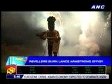 Revelers burn Lance Armstrong effigy