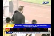 Beckham plays with kids during halftime