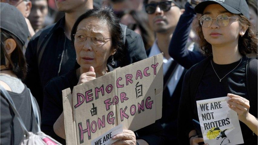 Hong Kong: Peaceful Protesters Throng Streets In Rain