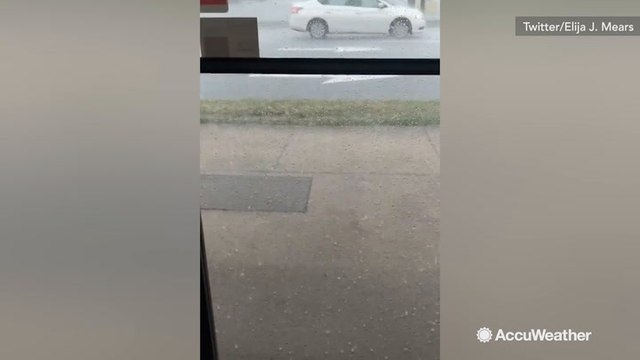 Giggly residents take cover inside as they watch the hail