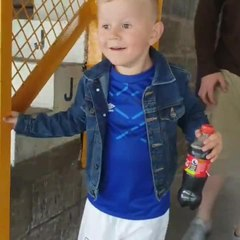 Dad Takes Little Boy to First Football Game at the Stadium
