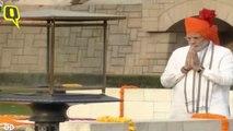 Prime Minister Narendra Modi pays tribute to Mahatma Gandhi at Rajghat