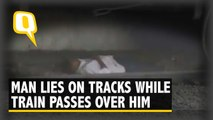 Caught on Camera: Man Lies on Tracks as Train Passes over Him