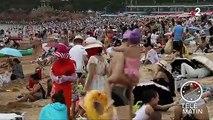 Sur les plages, face au soleil et aux méduses, les Chinois se mettent en combinaison intégrale