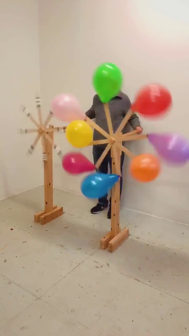 This Guy Takes Balloon Popping to a Whole New Level