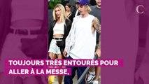 PHOTOS. Quand Justin Bieber essaye tant bien que mal de se cacher des photographes à la sortie de l'église