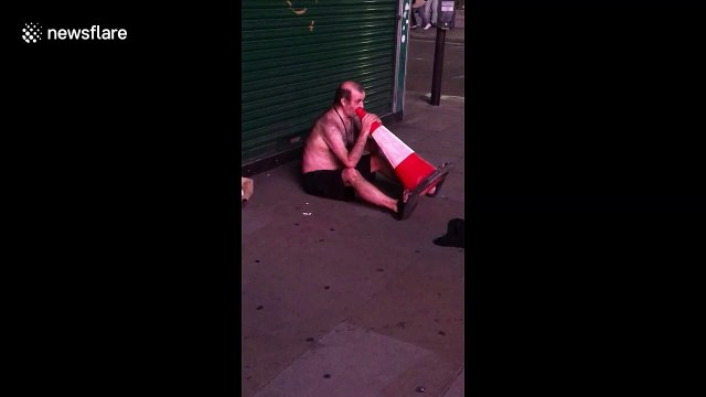 Man 'plays' traffic cone for cash