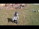 Little Boy Learns Dog Walking